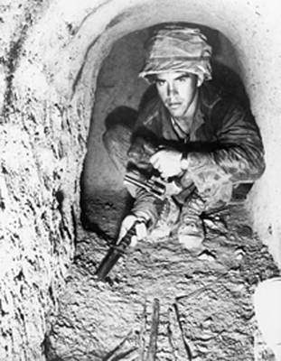Bsloc Photograph - American Soldier Using A Knife To Probe by Everett