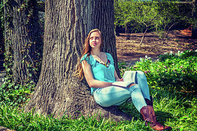 Photograph - American Teenage Girl Reading Book At Park In Spring Day In New  by Alexander Image