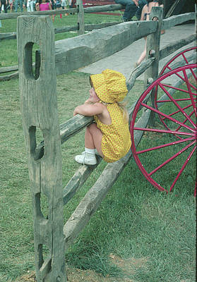 Photograph - Amish Girl On A Fence by Roger Green