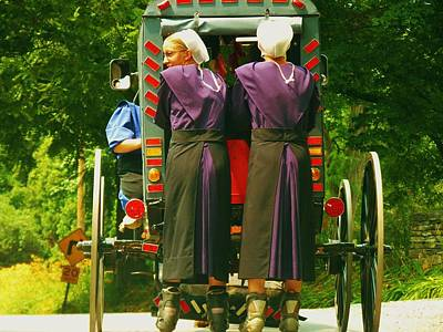 Amish Girls On Roller Blades Art Print by Jeanette Oberholtzer