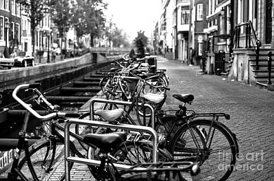Photograph - Amsterdam Bikes In A Row Mono by John Rizzuto