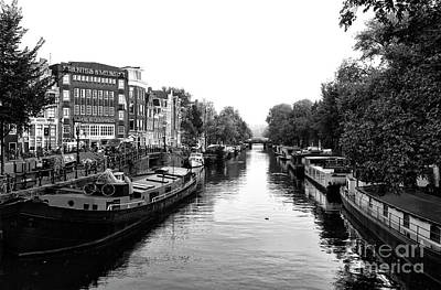 Photograph - Amsterdam Canal Day Mono by John Rizzuto