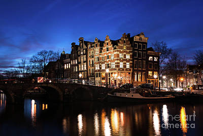 Photograph - Amsterdam Canal Houses Illuminated At Dusk by IPics Photography