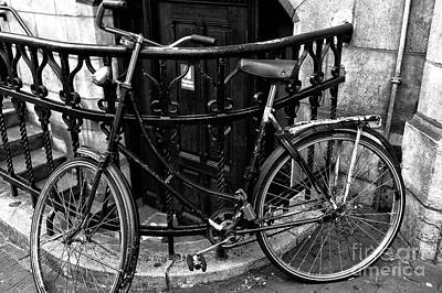 Bicycle Photograph - Amsterdam Curved Bike Mono by John Rizzuto