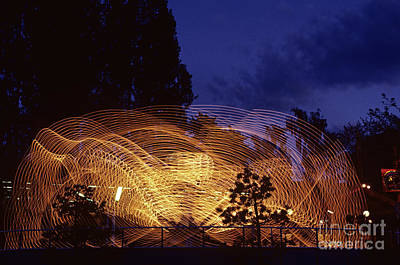 Photograph - Amusement Ride In Motion by Jim Corwin
