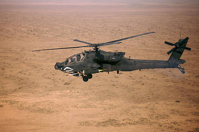 Camp Speicher Photograph - An Ah-64d Apache Longbow Fires A Hydra by Terry Moore