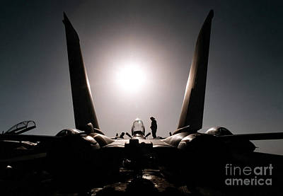 Politicians Royalty-Free and Rights-Managed Images - An Aircraft Mechanic Works On An F-14b by Stocktrek Images