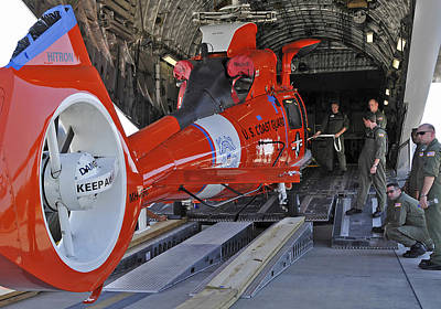 Photograph - An Aircrew Loads A Coast Guard Hh-65 by Stocktrek Images
