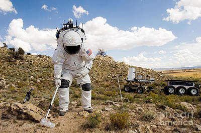 Photograph - An Astronaut Collects A Soil Sample by Stocktrek Images