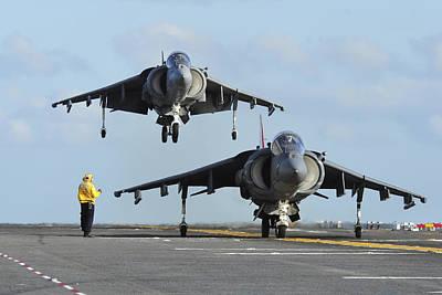 Av-8b Photograph - An Av-8b Harrier Prepares For Takeoff by Stocktrek Images