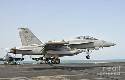 Popstar And Musician Paintings Royalty Free Images - An Ea-18g Growler Trap Landing Royalty-Free Image by Giovanni Colla