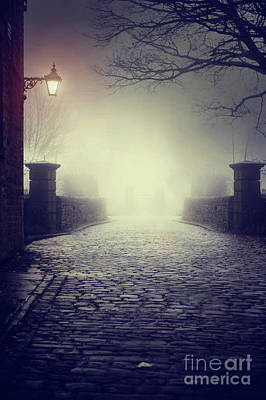 Photograph - An Eerie Cobbled Road At Night In Winter Fog by Lee Avison