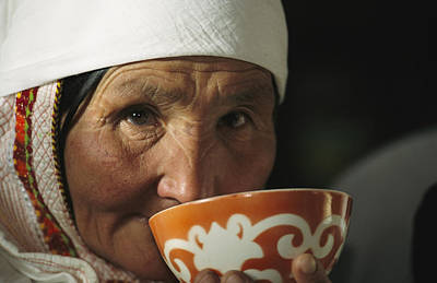 Elderly People Photograph - An Elderly Woman Drinks From A Cup by David Edwards