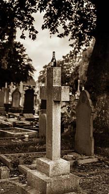 Photograph - An Empty Wine Bottle On The Cemetery Cross by Jacek Wojnarowski