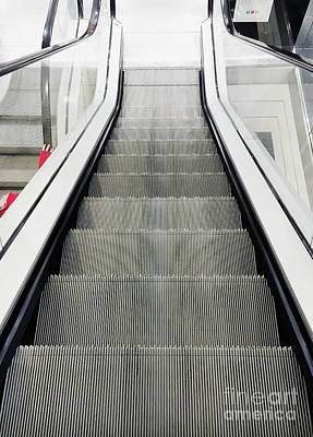An Escalator Art Print by Tom Gowanlock