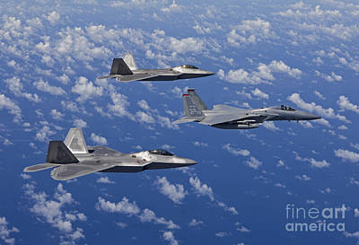 An F-15 Eagle And Two F-22 Raptors Fly Art Print by HIGH-G Productions