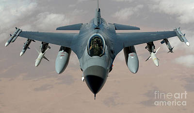 An F-16 Fighting Falcon Flies A Mission Art Print by Stocktrek Images