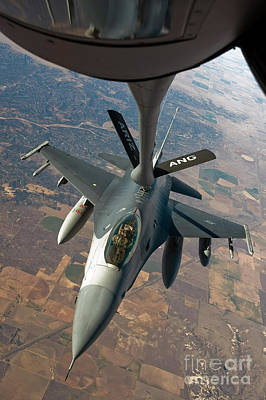 Stratotanker Photograph - An F-16 Fighting Falcon Receiving Fuel by Stocktrek Images