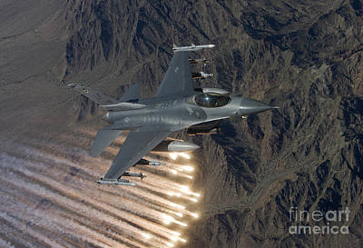 An F-16 Fighting Falcon Releases Flares Art Print by HIGH-G Productions