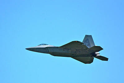 Photograph - An F-22 Raptor Taking Off by Don Mercer