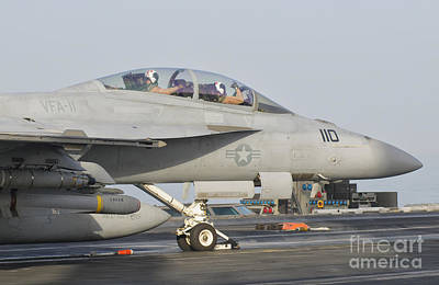 Transportation Royalty-Free and Rights-Managed Images - An Fa-18f Super Hornet Ready To Launch by Giovanni Colla