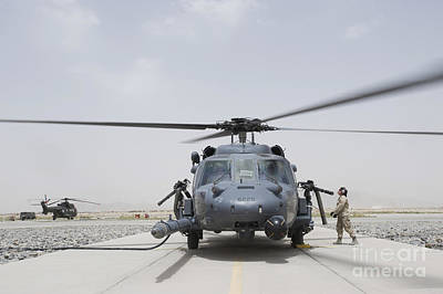 Rotary Wing Aircraft Photograph - An Hh-60 Pave Hawk Lands After A Flight by Stocktrek Images