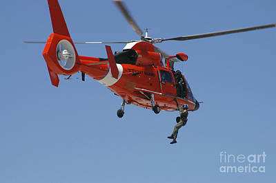 Photograph - An Hh-65c Dolphin Demonstrates by Stocktrek Images