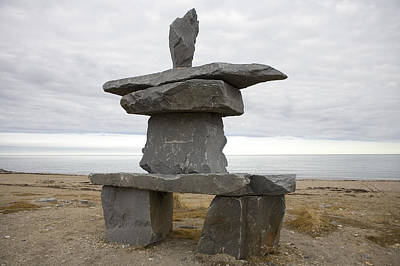 Inukshuk Photograph - An Inuit Inukshuk Stands By Hudsons Bay by Taylor S. Kennedy