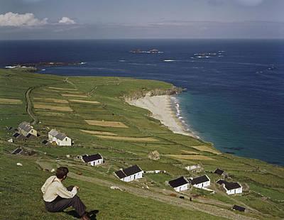 An Irishman Overlooks Cottages That Art Print by Howell Walker