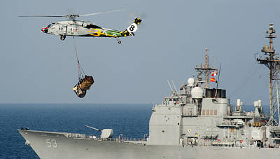 Carrie Painting - An Mh-60s Sea Hawk Helicopter Carries Pallets by Celestial Images