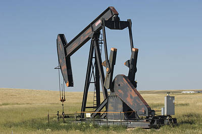 State Of Montana Photograph - An Oil Rig Pumps Oil From The Montana by Joel Sartore