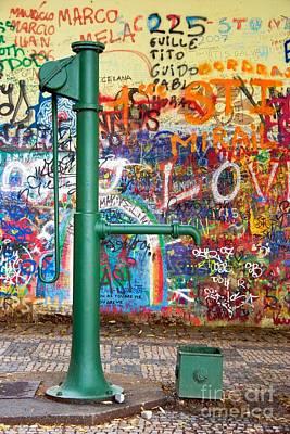An Old Pump And Lennon Wall In Prague Art Print by Hideaki Sakurai