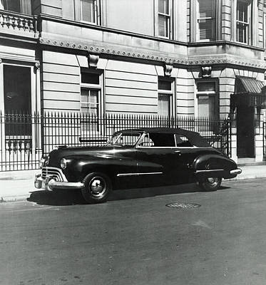 Street Scenes Photograph - An Oldsmobile Car by Constantin Joffe