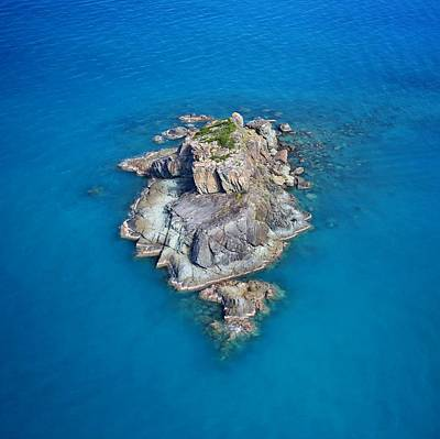 Photograph - An Outcrop Of Rock Surrounded By Sea In The Whitsundays by Keiran Lusk