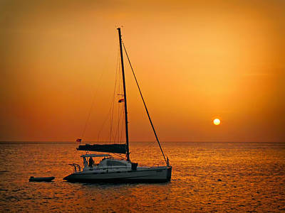 Photograph - Anchored Sailboat At Sunset by Carolyn Derstine