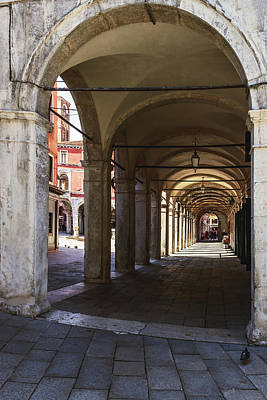Photograph - ancient arches shopping arcade in the old part of Venice by George Westermak