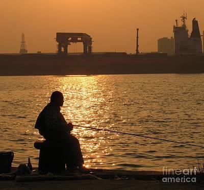 Photograph - Angler At Sunset by Yali Shi