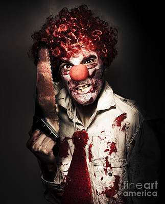 Angry Horror Clown Holding Butcher Saw In Darkness Art Print