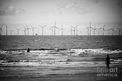 Another Place Photograph - anthony gormleys another place on Crosby beach part of the crosby coastal park liverpool with wind f by Joe Fox