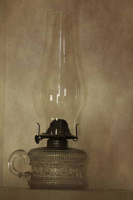 Photograph - Antique Glass Hurricane Lamp In Sepia Post Processed Photograph by Colleen Cornelius