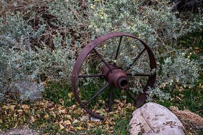 Wagon Wheel Hub Wall Art - Photograph - Antique Steel Wagon Wheel by Paul Freidlund