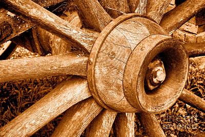 Wagon Wheel Hub Wall Art - Photograph - Antique Wagon Wheel - Sepia by Olivier Le Queinec