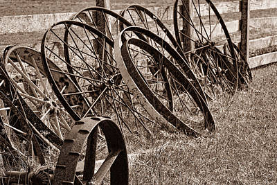 Sepia Tone Photograph - Antique Wagon Wheels II by Tom Mc Nemar