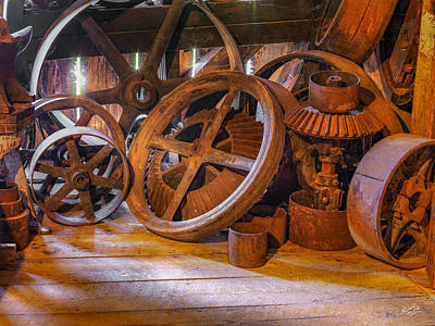 Photograph - Antique Wheels And Gears by Leland D Howard