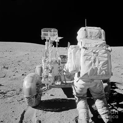 Apollo 16 Astronaut Reaches For Tools Art Print by Stocktrek Images