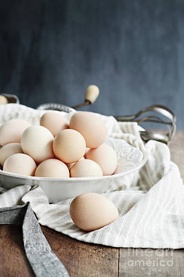 Photograph - Apron And Eggs On Wooden Table by Stephanie Frey