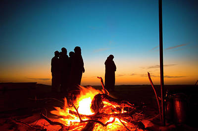 Photograph - Arab men praying Ishaa in the desert beside a fire place by Hany Musallam