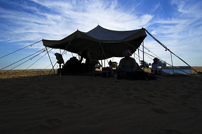 Photograph - Arab men resting under a tent in the desert by Hany Musallam
