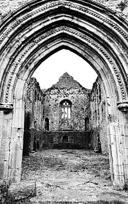 Photograph - Athassel Priory Tipperary Ireland Medieval Ruins Decorative Arched Doorway Into Great Hall Bw by Shawn O'Brien