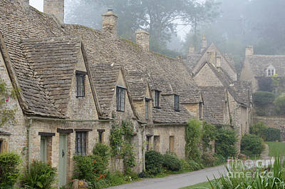Photograph - Arlington Row, Bibury In The Morning Fog by IPics Photography